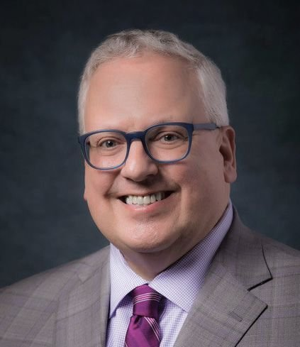 Dr. Chris M. Reber