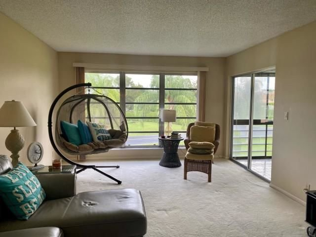 SOLD!  THIS LOVELY 2ND FLOOR CONDO IN PALM GREENS