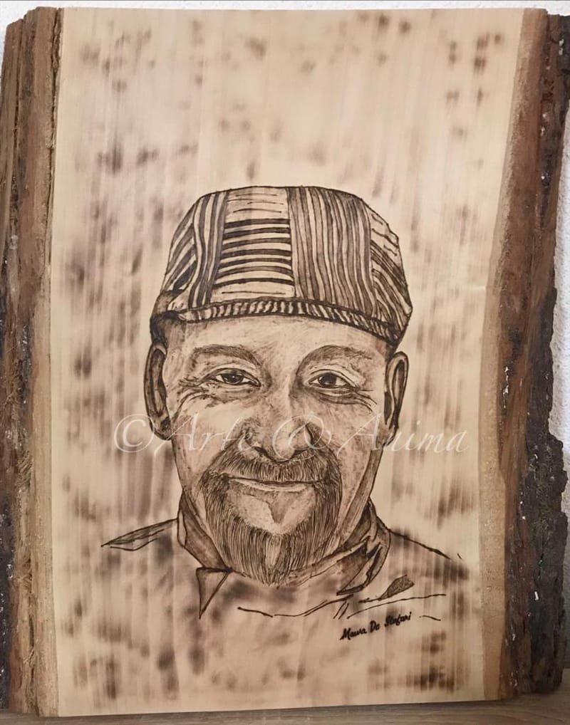 Ritratto su legno grezzo con pirografo