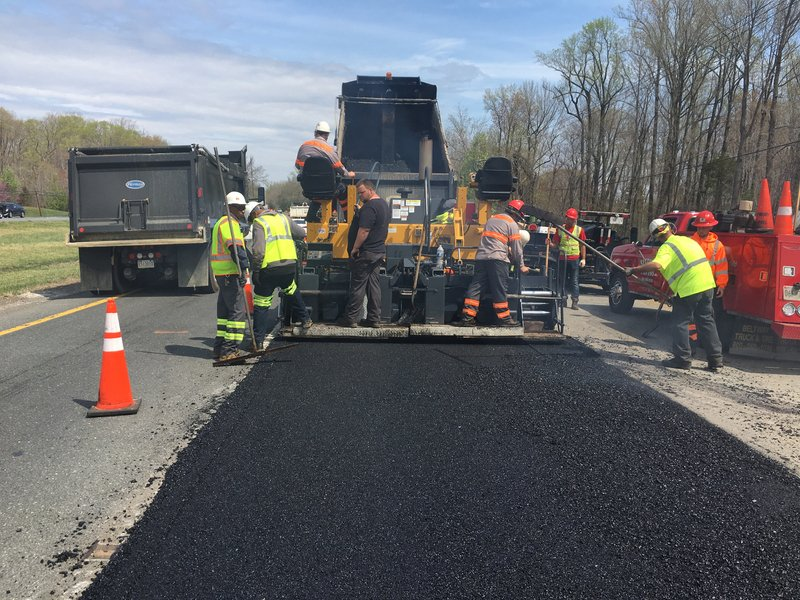 Paving new asphalt roads for homes and business centers